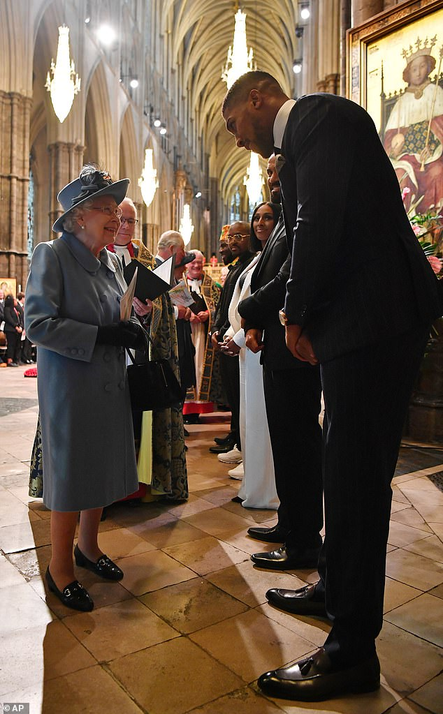 Anthony Joshua, 30, was introduced to the Queen, 90, following the Commonwealth Day Service at Westminster Abbey in London this afternoon, pictured