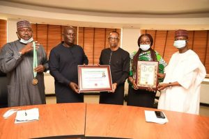 L- R: Bashir Bello, Head, Legislative and Government Relations, Nigerian Communications Commission (NCC); Hon. Uchechukwu Chukwuma, Director General, National Association of State Assembly Legislators (NASAL); Dr. Ikechukwu Adinde, Director, Public Affairs, NCC; Truddy Tony-Awusaku, Principal Manager, Public Affairs, NCC; Hon. Usman Ali, Co-ordinator, North-West Zone, NASAL, during the  presentation of National Award of Excellence to Prof. Umar Garba Danbatta, Executive Vice Chairman/CEO, NCC by NASAL at the Commission's Headquarters Abuja. Adidnde received the award on behalf of the EVC.
