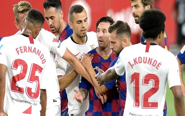 Players try to calm Barcelona's Argentinian forward Lionel Messi (C) during the Spanish league football match between Sevilla FC and FC Barcelona at the Ramon Sanchez Pizjuan stadium in Seville on June 19, 2020.